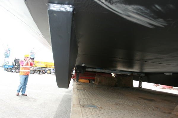 Port side fin to provide greater stability and maneuverability when negotiating windier weather and stronger river currents