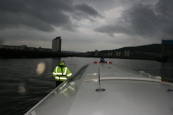 With dark clouds and rain falling, Copper Jack has second thoughts about heading to the open sea and turns towards Swansea