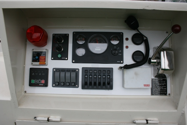 Engine, generator and thruster controls and various electrical switches, depth sounder (currently covered), bilge alarms, tannoy and manual fire switch/alarm.