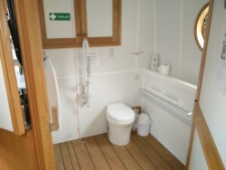 Copper Jack's accessible toilet (with hand basin behind door and foldaway baby change table on wall)